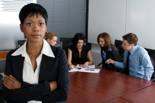 Professionals sitting in a board room